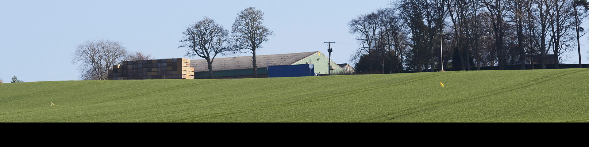 Farm field with farm building