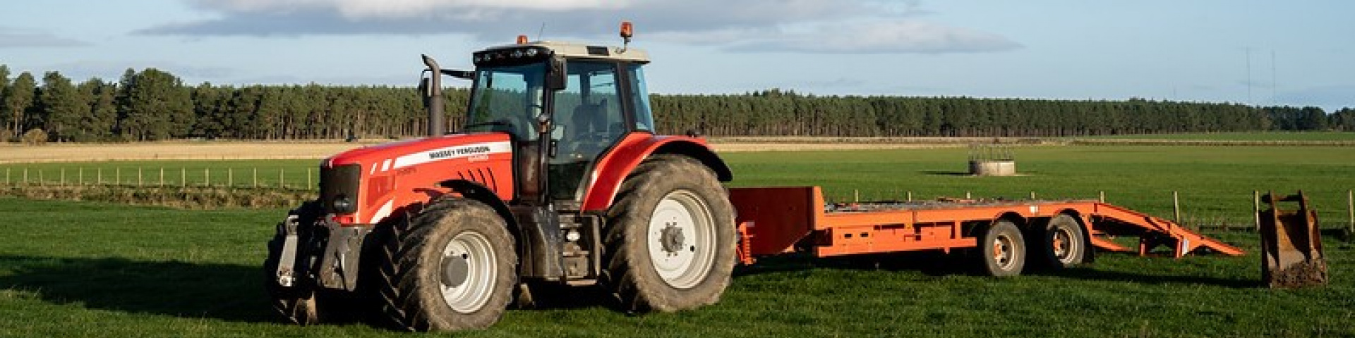Red tractor on agricultural land in Scotland. Credit: Rural Matters.