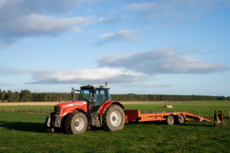Red tractor on agricultural land in Scotland. Credit: Rural Matters