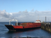Timber ready to be 'eiggxported' from the Isle of Eigg by ship.