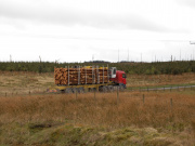 A timber lorry traveling across Eskdalemuir.