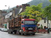 A timber lorry driving through Callander, Perthshire.