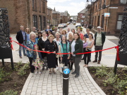 DG1 Neighbours celebrating after Dumfries and Galloway Council received the Civic Champion prize at the Scottish Civic Trust 'My Place' Awards for their support to the Dumfries Street Design Project. Image courtesy of Sustrans Scotland.