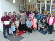 The DG1 Neighbours group proudly holding their Civic Champions certificate. Image courtesy of Sustrans Scotland.